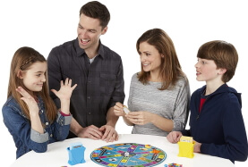 family playing trivial pursuit board game
